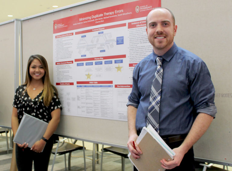 Pharmacy students Mike Konietzko and Charina Ruiz participate in the PharmD poster session