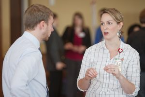 A PharmD student chats with a pharmacy manager at the annual career fair.